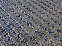 Luggage trollies. Neatly arranged to form pattern Royalty Free Stock Photography
