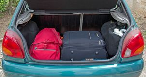 Luggage in the trunk of the car. On vacation Stock Photos