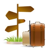 Luggage and wooden sign Royalty Free Stock Photos