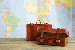 Luggage on world map background. Travel concept Stock Images