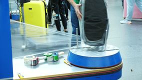 Luggage wrapping service in airport for security reason and safety protection from damage.