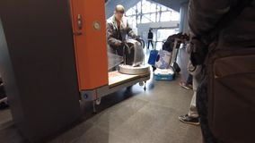 Luggage wrapping service at the VNUKOVO airport stock video footage