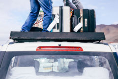Luggages and Bags arranged on the car roof ready for a trip in sky background Royalty Free Stock Photography