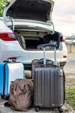 Luggages before loading onto car trunk royalty free stock photos