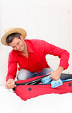 Luggaging packing man at home Royalty Free Stock Image