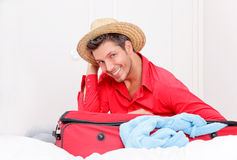 Luggaging packing man at home Royalty Free Stock Images