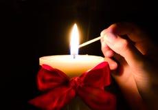 Lughting Christmas candle. Isolated on black Stock Photo