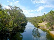 Lugna Blackwoodflod på en solig dag Arkivfoto