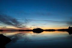Lugna solnedgång på havet royaltyfri foto