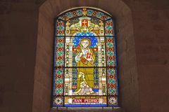 Stained glass window of the cathedral of Lugo. Lugo, Galicia, Spain. 01/13/2018: Stained glass window of the cathedral of Lugo, with Saint Peter stock photography