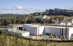 Factory in the town. Lugo, Spain-Octuber 2018. You can see a factory in the town surrounded by nature in a sunny day stock photos
