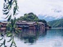Lugu Lake Inn. Lugu Lake, Yunnan, China. Summer travel.Inn、hotels along the lake side Stock Photos