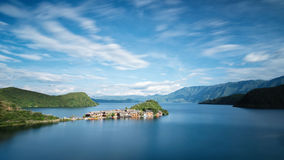 Lugu Lake. Lies 200 kilometers approximately 124 miles from the center of Lijiang city, on the border between Ninglang county in Yunnan province and Yanyuan Royalty Free Stock Photos
