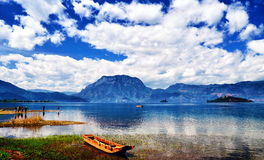 The Lugu Lake. Lugu Lake lies 200 kilometers from the center of Lijiang City, on the border between Ninglang County in Yunnan Province and Yanyuan County in Stock Images