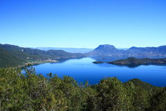 Lugu lake scenic, China. The landscape of on Lugu lake,Scenic view of Lugu Lake with mountains in background,  Yunnan Province, China Royalty Free Stock Image