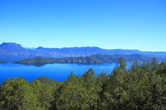 Lugu lake scenic, China. The landscape of on Lugu lake,Scenic view of Lugu Lake with mountains in background,  Yunnan Province, China Stock Photos