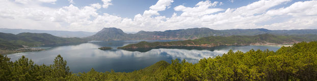 Lugu Lake in Yunnan, China. Scattered clouds rise above Lugu Lake in northern Yunnan province, China Stock Image