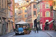 Luigi Carlo Farini-straat met gekleurde gebouwen in oude historisch Royalty-vrije Stock Afbeeldingen