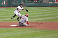 Luis Cruz of Pittsburgh Pirates. Completes a double play as Brandon Phillips of thet Cincinnati Reds slides on September 24, 2009 in Pittsburgh, PA Stock Photo