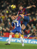 Luis Garcia and Maxwell. Luis Garcia (L) of Espanyol and Maxwell(R) of Barcelona during Spanish league match between Barcelona and Espanyol at Camp Nou stadium Royalty Free Stock Image