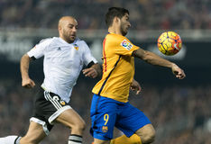 Luis Suarez. Of FC Barcelona and Aymen Abdennour of Valencia in action during the match between Valencia and FC Barcelona Stock Image