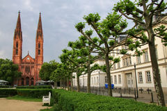 Luisenplatz square with St. Bonifatius church and residential bu. Ildings in Wiesbaden, Hesse, Germany. Wiesbaden is one of the oldest spa towns in Europe stock photo