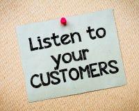 Luister aan uw klanten stock foto
