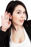 Luister concept - één nieuwsgierige vrouw royalty-vrije stock foto's
