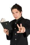 Luister me! Priester met heilige bijbel royalty-vrije stock afbeeldingen