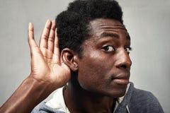 Luister zwarte mens royalty-vrije stock foto's