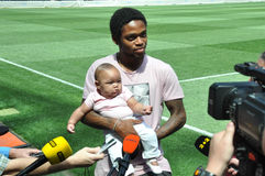 Luiz Adriano on the field with daughter Royalty Free Stock Photo
