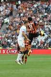 Luiz Adriano jumping for the ball Stock Image