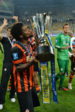 Luiz Adriano is kissing a cup Stock Photos