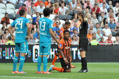 Luiz Adriano kneeling in front of the referee Royalty Free Stock Photo