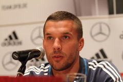 Lukas Podolski. WARSAW, POLAND - OCTOBER 10, 2014: Lukas Podolski, German national football team and Arsenal London player attends a press conference before the Royalty Free Stock Photo