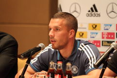 Lukas Podolski. WARSAW, POLAND - OCTOBER 10, 2014: Lukas Podolski, German national football team and Arsenal London player attends a press conference before the Royalty Free Stock Image
