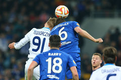 Lukasz Teodorczyk fights for the ball with Phil Jagielka in the air, UEFA Europa League Round of 16 second leg match between stock photo