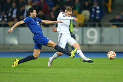 Lukasz Teodorczyk shoots the ball while Antolin Alcaraz tries to block it, UEFA Europa League Round of 16 second leg match between royalty free stock photo
