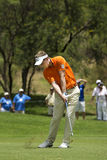 Luke Donald - Fairway Shot. Luke Donald, plays an iron shot, up toward the green, on the first fairway Royalty Free Stock Photo