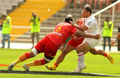 Luke McAlister of Stade Toulousain. Luke McAlister(R) of Stade Toulousain is tackled by USAP player during the French rugby union league match against USAP Royalty Free Stock Image