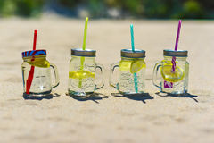 Lukecin, Poland, June 15, 2017: Cold drinks in jar on the beach. Royalty Free Stock Images