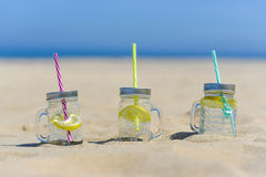 Lukecin, Poland, June 15, 2017: Cold drinks in jar on the beach. Stock Images