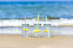 Lukecin, Poland, June 15, 2017: Cold drinks in jar on the beach. Royalty Free Stock Image
