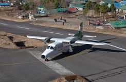 Aircraft Landing on Tenzing - Hillary Airport Runway in Nepal stock photos