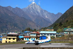 Lukla, Nepal-Oct 22, 2012: Sita aircraft is ready to take off from Lukla airport runway. Royalty Free Stock Image