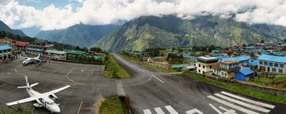 Small plane taking off from from Tenzing-Hillary Airport. Lukla, Nepal - October 9, 2017: small plane in Tenzing-Hillary Airport - the most dangerous airport in stock photos