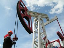 LUKOIL. Worker overhauling a pump jack of LUKOIL company Royalty Free Stock Photos