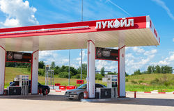 Lukoil gas station with fueling cars. Lukoil is the largest privately owned oil and gas company in the world by proved oil. BOROVICHI, RUSSIA - JUNE 26, 2016 stock images
