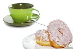 Lukrowi i rozpryskani donuts i filiżanka Obraz Stock