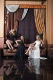 Luksusowe dziewczyny w wieczór sukniach piękne fotografia stock